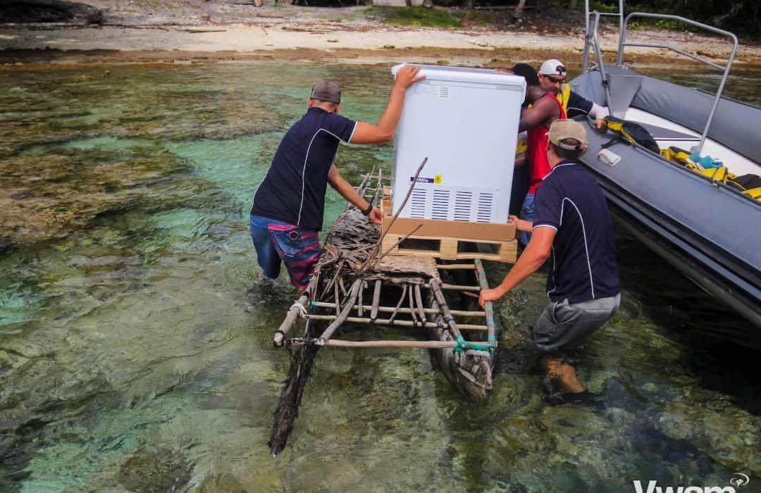 YWAM fridge being carried in Canoe