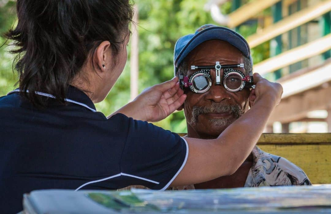 YWAM PNG male getting eyes tested