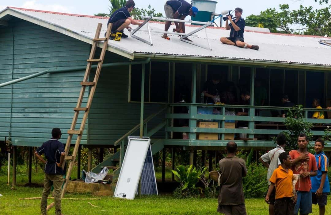 YWAM solar panels being installed on PNG village hospital